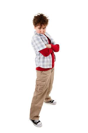 persona enojada: Ofendido ni�o de pie sobre fondo blanco Foto de archivo