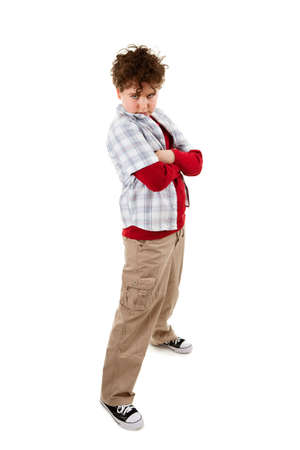 anger kid: Offended boy standing on white background