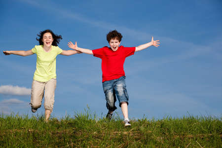 13: Girl and boy running, jumping outdoor