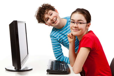 Kids using computer isolated on white background photo