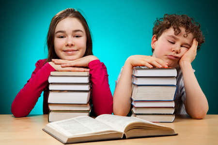 13 14 years: Girl and boy learning  Stock Photo