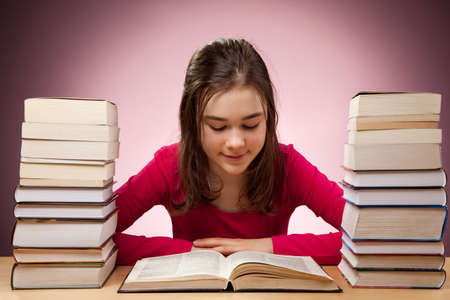 13 14 years: Girl reading book Stock Photo