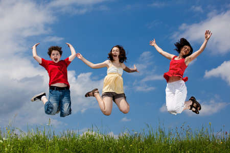 leaping: Active family - mother and kids running, jumping outdoor Stock Photo