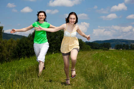 Girls running, jumping outdoor photo