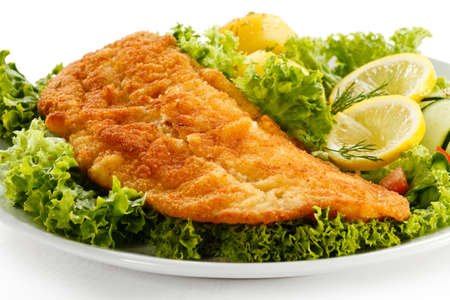 fried fish: Fish dish - fried fish fillet with vegetables
