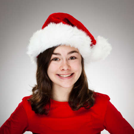 Portrait of beautiful girl wearing Santa Claus hat photo