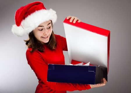 Portrait of beautiful girl wearing Santa Claus hat Stock Photo - 13822120