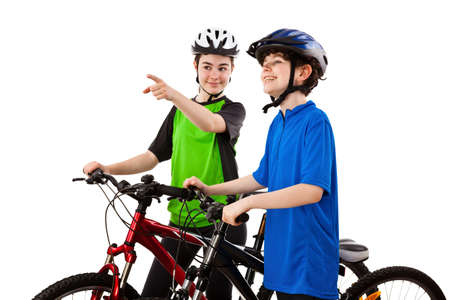Cyclists - boy and girl isolated on white background photo
