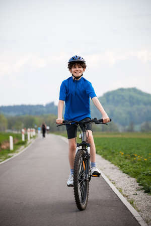 Boy biking photo