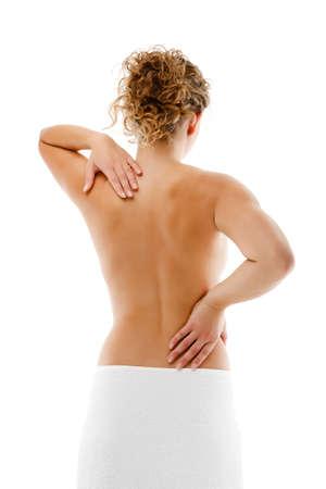 Woman massaging pain back isolated on white background Stock Photo - 14228772