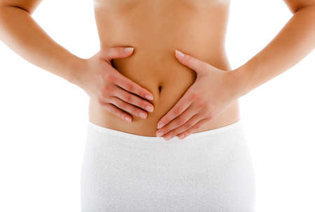 Woman massaging pain stomach isolated on white background photo