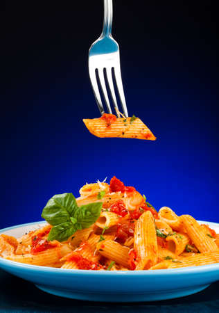 grated: Pasta with tomato sauce and parmesan Stock Photo