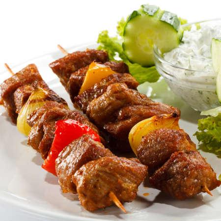 shashlik: Kebab - grilled meat and vegetables Stock Photo