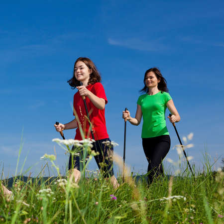 nordic walking: Active family - mother and daughter exercising outdoor