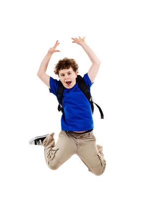 Boy jumping, running isolated on white background photo