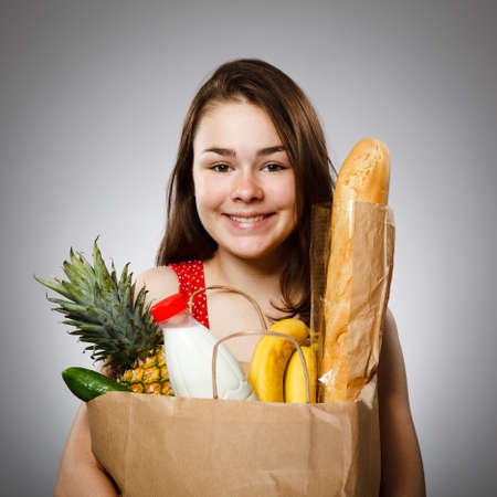 pastry bag: Girl holding shopping bag Stock Photo
