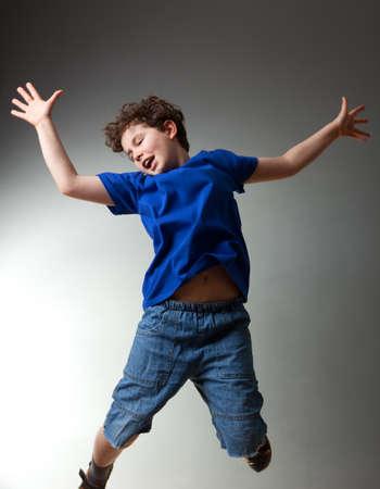 Boy jumping photo