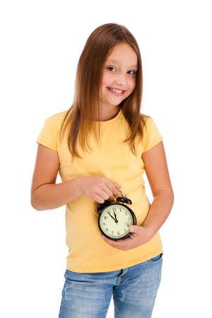 8 9 years: Girl holding alarm-clock isolated on white background Stock Photo