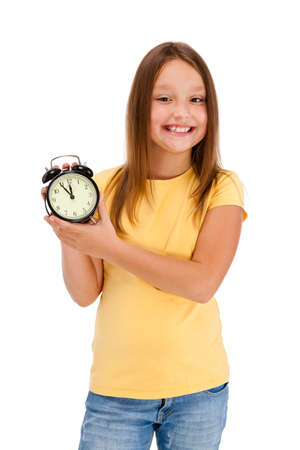 Girl holding alarm-clock isolated on white background photo