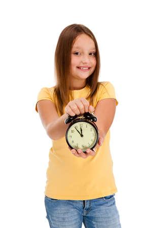 one female: Girl holding alarm-clock isolated on white background Stock Photo