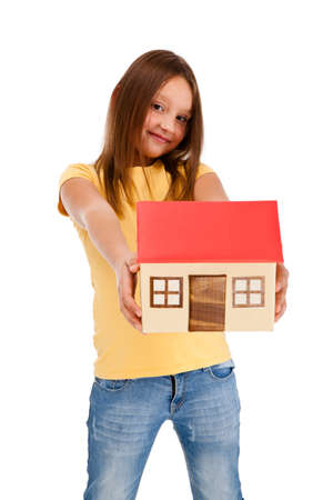 8 9 years: Girl holding model of house isolated on white Stock Photo