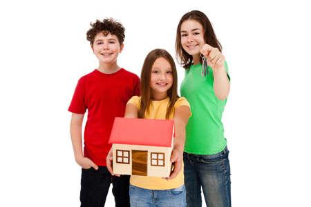 Kids holding model of house isolated on white photo