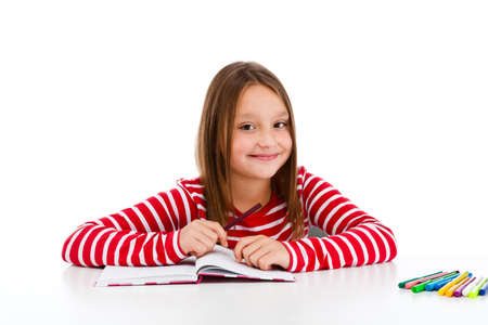kids writing: Girl learning isolated on white background Stock Photo
