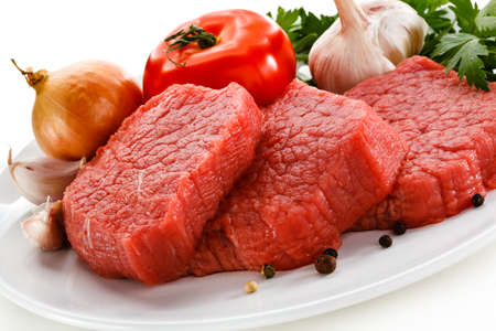 Raw beef on white background  Stock Photo