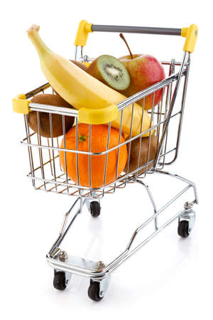 Shopping trolley full of oranges on white background photo