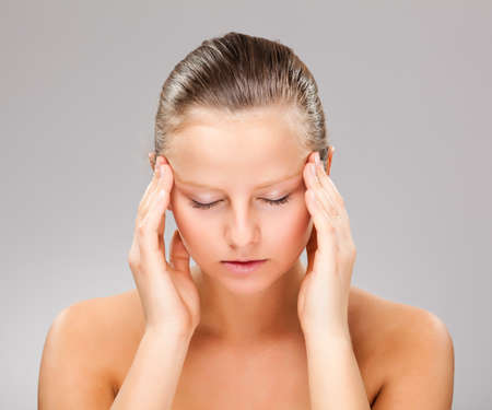Woman massaging pain head Stock Photo - 14565679