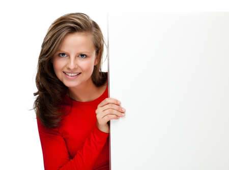 Young attractive girl behind empty board on white background Stock Photo - 14565567