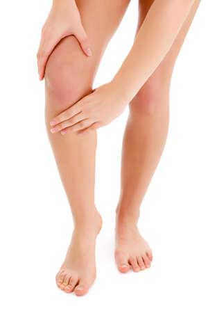 Woman massaging pain knee photo