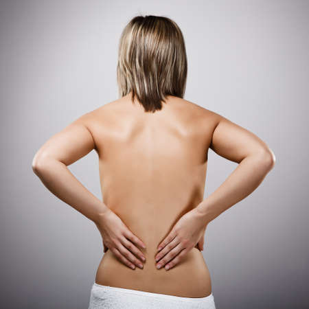 Woman massaging pain back Stock Photo - 14584097