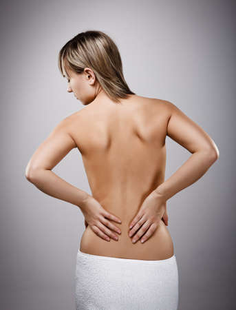 Woman massaging pain back Stock Photo - 14584139