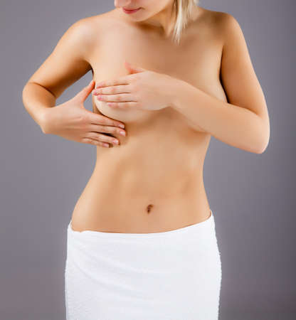 Woman examining her breast photo