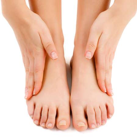 Woman massaging legs photo