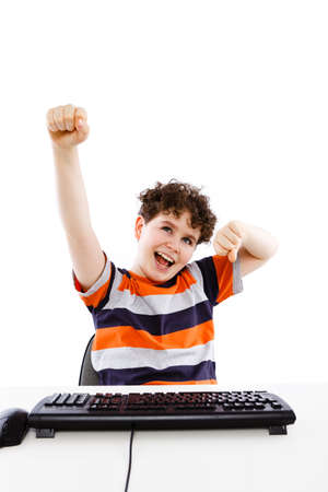 Boy using computer isolated on white background photo