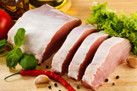 Raw pork on cutting board and vegetables Stock Photo - 14593926