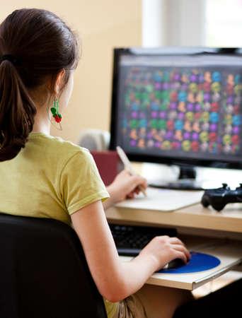 using computer: Girl using computer at home Stock Photo