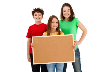 8 9 years: Kids holding noticeboard isolated on white background