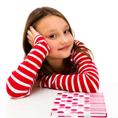 8 9 years: Girl learning isolated on white background Stock Photo