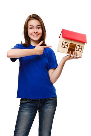 Girl holding model of house isolated on white background photo
