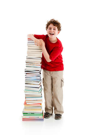 Student standing close to pile of books on white background photo