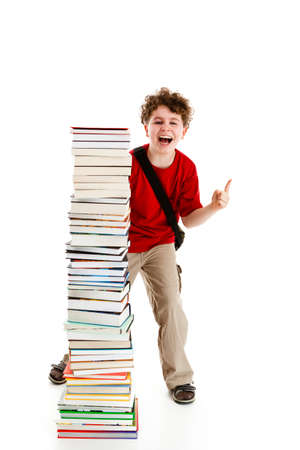 Student standing close to pile of books on white background Stock Photo - 14625046