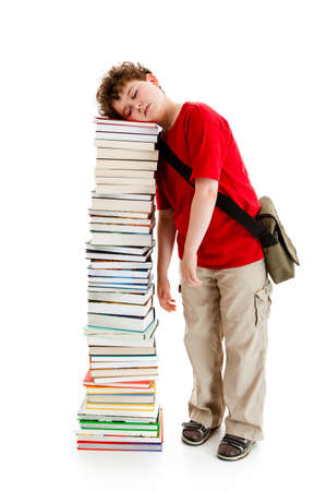 sleeping kid: Student standing close to pile of books on white background