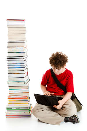 Student sitting close to pile of books on white background Stock Photo - 14625099