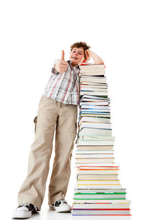 Student standing close to pile of books on white background Stock Photo - 14625095