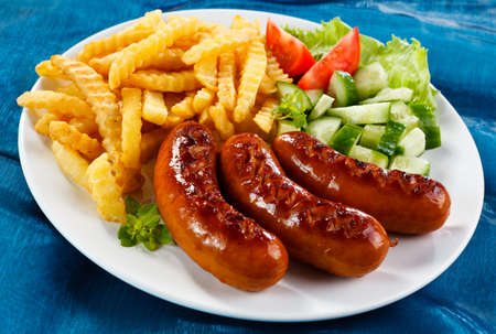 bratwurst: Grilled sausages, French fries and vegetables