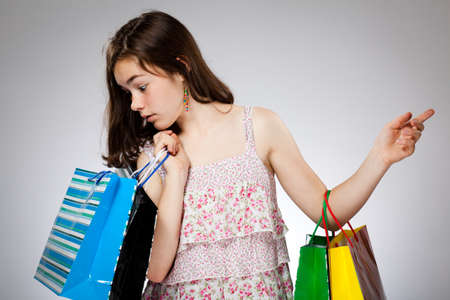 Girl holding shopping bags photo