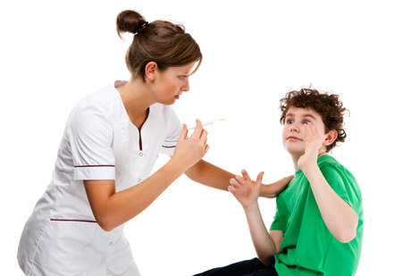 Nurse giving young boy injection isolated on white background photo